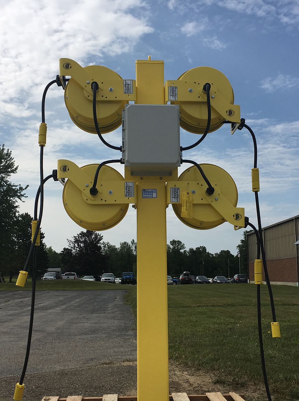Outdoor Bus Fleet Industrial Grade Cord Reel Station. Safely Power Engine Block Heaters.